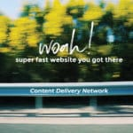 Blog Featured Image | Content Delivery Network - What the What? Featuring a blurred image of trees and a guardrail from a moving car's perspective.